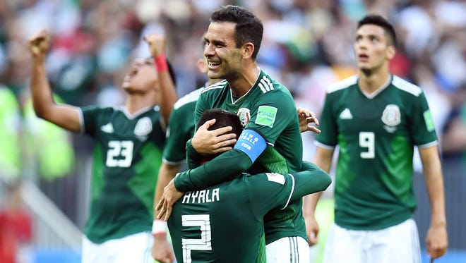 Mexico players Hugo Ayala and Rafael Marquez celebrate after defeating Germany.