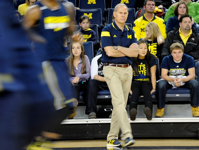 Michigan head coach John Beilein watches the team during