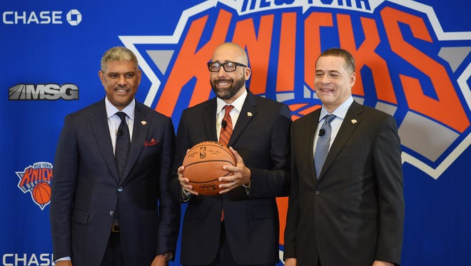 Knicks new head coach David Fizdale (C) is introduced by Steve Mills (L),President and Scott Perry (R), General Manager as they pose for photos during a press conference at Madison Square Garden in New York  on 05/08/18.