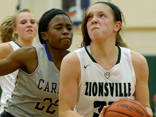 Zionsville Eagles Rachel McLimore (32) drives to the