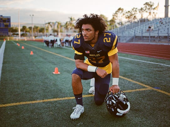 """Naples running back Cesare """"Chez"""" Mellusi takes a knee,"""