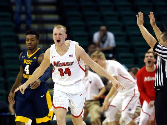 Marist's David Knudsen celebrates a 3-pointer against West Virginia on Nov. 23, 2017.