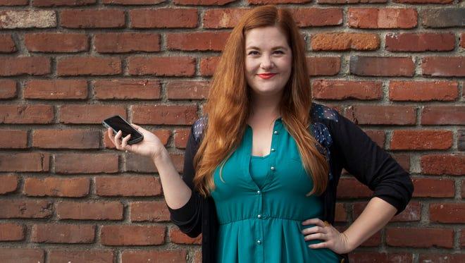 St. Cloud State University graduate Alexandra Tweten poses with her mobile phone in November 2014 in Los Angeles.