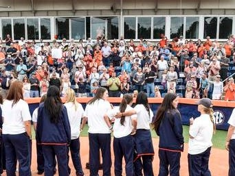 Fans welcome the Auburn softball team back from the Women's College World Series on Monday.