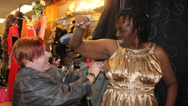 Carmen Reliferd and Carol Johnson shop at Vintage Etcetera for a dress for high tea on Small Business Saturday.