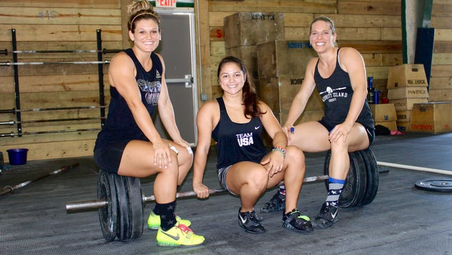 Julia Glotz (L), Juliette Chang-Fane and Jessica Beal compete for national and world titles in women's weightlifting events. The three regularly train together at Maverick and Merritt Island CrossFit.