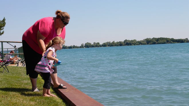 Joy Yax and her daughter, Deziray Yax, 3, fish on the St. Clair River in Marine City.
