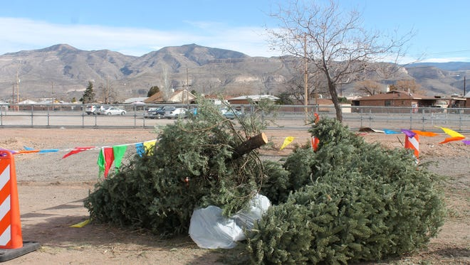 Residents leave their old Christmas trees in designated areas at the Sgt. Willie Estrada Memorial Civic Center and the Alamogordo Senior Center.