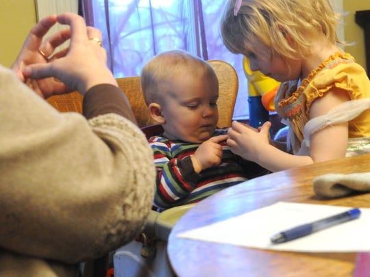 Mira Mueller, 3, tries to get her 11-month-old brother, Indigo Mueller, to make the sign for ball with encouragement from parent-infant educator and outreach coordinator Kathy Guisewite of the Virginia School for the Deaf and the Blind during a session in their home on Tuesday, Jan. 22, 2013. Indigo was born deaf. Mike Tripp/The News Leader Mira Mueller, 3, tries to get her 11-month-old brother, Indigo Mueller, to make the sign for ball with encouragement from parent-infant educator and outreach coordinator Kathy Guisewite of the Virginia School for the Deaf and the Blind during a session in their home on Tuesday, Jan. 22, 2013. Indigo was born deaf.