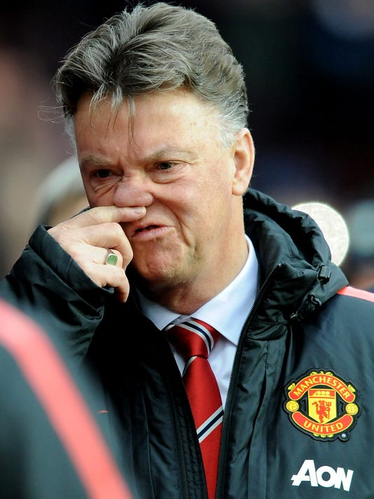 Manchester United manager Louis van Gaal arrives on the pitch before the start of the English Premier League soccer match between Aston Villa and Manchester United at Villa Park, in  Birmingham, England, Saturday, Dec. 20, 2014.  (AP Photo/Rui Vieira)
