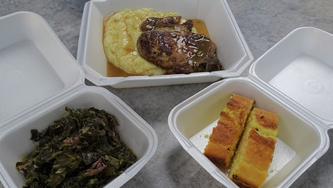 The smothered pork chops with mashed potatoes, greens and cornbread is one of the specials offered at Sarah's Fresh Fish Market & Deep Water Seafood Delights.