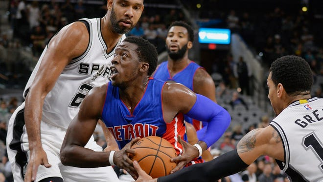 Detroit Pistons guard Reggie Jackson, center, prepares to shoot against San Antonio Spurs forward Tim Duncan, left, and Spurs guard Danny Green during the first half. Jackson finished with 20 points as the Pistons fell to the Spurs 96-92 Sunday.