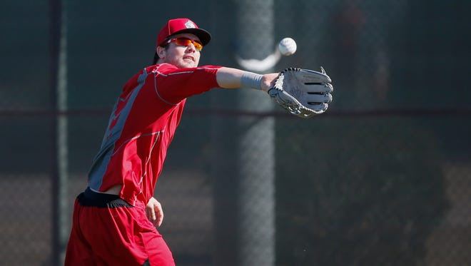 Cincinnati Reds outfielder Jesse Winker catches a fly ball during batting practice at Cincinnati Reds spring training, Saturday, Feb. 20, 2016, in Goodyear, Arizona.