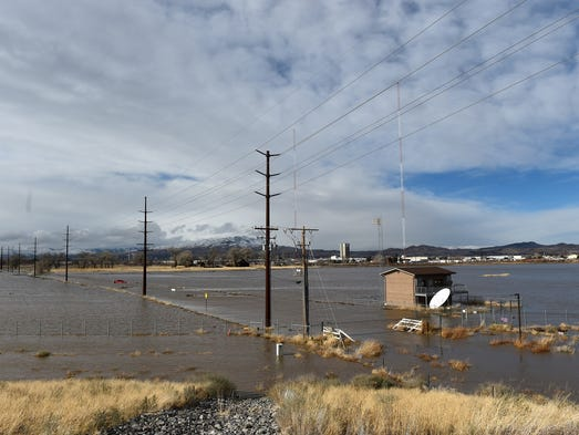 Standing water is seen on the flood plain surrounding