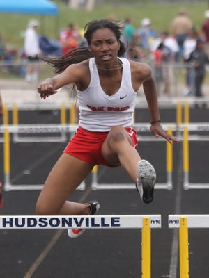 Brianna Holloway from Oak Park high school finishes first in the 300 meter hurdles at the MHSAA Divison One State Track and Field championships on Saturday, June 4, 2016 at Hudsonville Eagles Stadium in Hudsonville MI. Kirthmon F. Dozier/Detroit Free Press