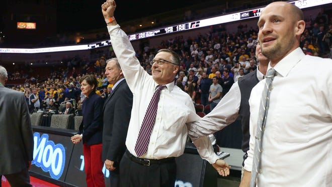 Western Christian boys' basketball coach Jim Eekhoff celebrates winning the Class 2A state title, the final game of his coaching career.