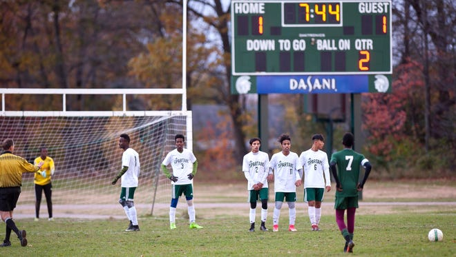 Peoples' Mikell McKenzie (7) lines up a free kick late in the second half during the Division III semifinals on Tuesday afternoon in Winooski.
