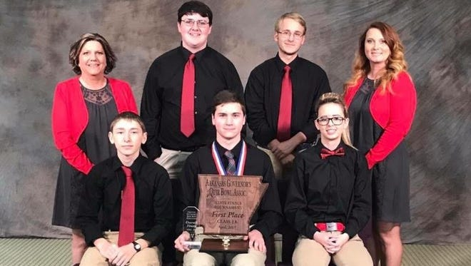 Norfork Senior High School Quiz Bowl team wins the state championship April 22: (back row) coach Pam Braun, Bentley Branscum, Jacob Moore and coach Stacy Havner; (front row) Jordan Weber, captain Elias Maple and Kristin Kite.