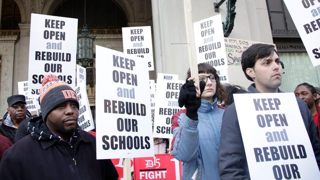 Members of the Detroit Public Schools and the community protest outside of Cadillac Place in Midtown Detroit on Friday, Feb. 17, 2017.
