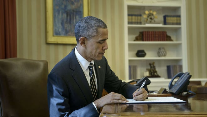 President Obama signs the executive order.