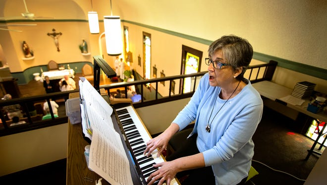 Sister Lorraine Lauter leads choir the choir during the Sunday service at St. John's Chrysostom Church.    May 17, 2015