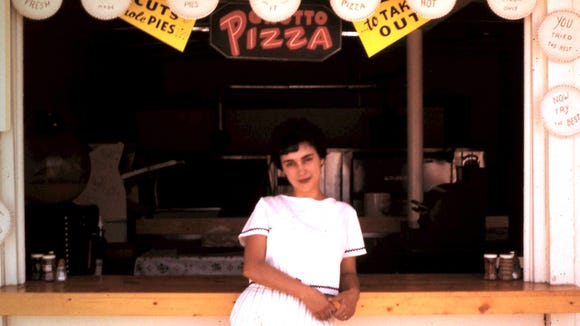 Mary Jean Paglianite, the sister of Grotto Pizza founder Dominick Pulieri, stands in front of the original slice shack on Rehoboth Avenue in 1960.