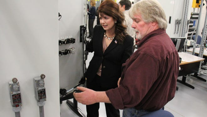Rebecca Kleefisch, lieutenant governor of Wisconsin, receives a tour of Moraine Park Technical College's West Bend Campus during a Veterans Services Summit held at the college. Shown here with Kleefisch is DeWayne Sexton, one of the Student Veterans at Moraine Park.