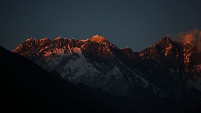In this Thursday, Feb. 18, 2016, photo, Mount Everest, center, and Mount Lhotse, right, are seen from Tengboche, Nepal.