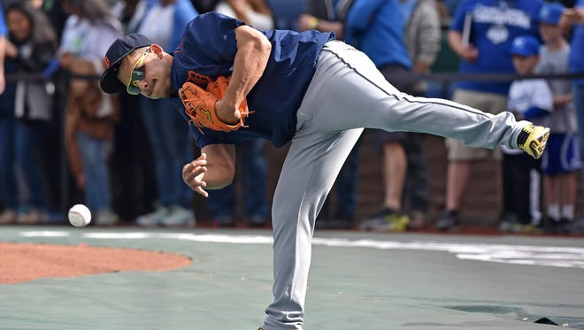 Tigers shortstop Jose Iglesias (1) warms up during batting practice prior to a game Thursday in Kansas City, Mo.