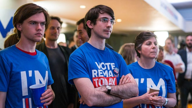 Supporters of the Stronger In campaign react after hearing results in the EU referendum at London's Royal Festival Hall Friday June 24, 2016. On Thursday, Britain voted in a national referendum on whether to stay inside the European Union.