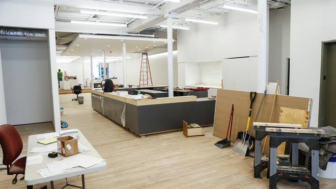A view of the first floor lobby inside at the Kentucky Museum of Art and Craft, 715 W. Main St, that reopens July 1. There will be a new centralized front desk area to help visitors navigate the museum. June 29, 2016