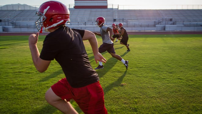 The Desert Mirage High School football team runs through drills at pre-season practice in preparation for the upcoming fall season, Monday, August 1, 2016.
