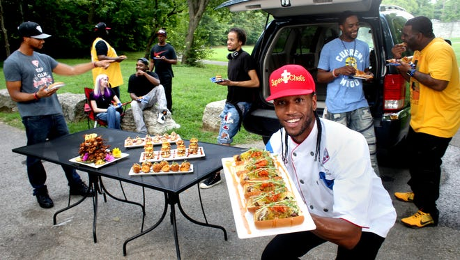 """Darnell Ferguson owner of SuperChef's restaurant staged a fabulous tailgating party with friends and staff. Renowned for """"urban eclectic"""" cuisine, Ferguson is set to open his DINNER comic book theme nightspot in late September."""