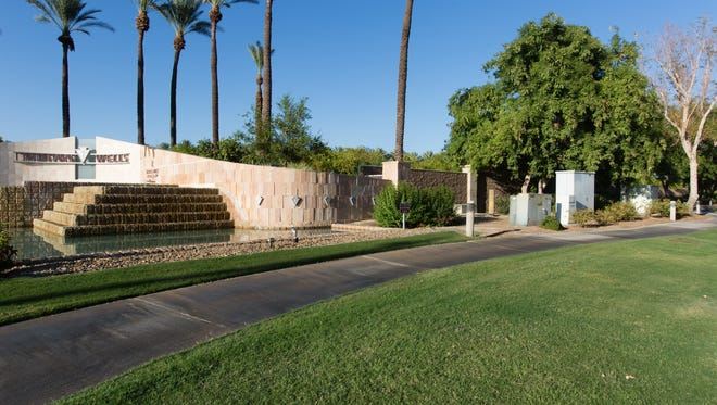 A sound wall, intended to shield golfers from the noise of Highway 111, extends from the entrance of the Indian Wells Golf Resort.