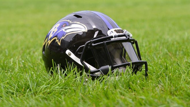 A detailed view of an Baltimore Ravens helmet  in the grass after practice at Under Armour Performance Center.