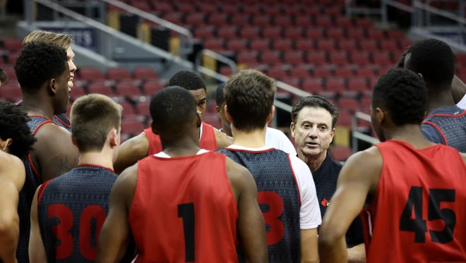 Louisville's Rick Pitino talks with the team before practice.Oct. 11, 2016