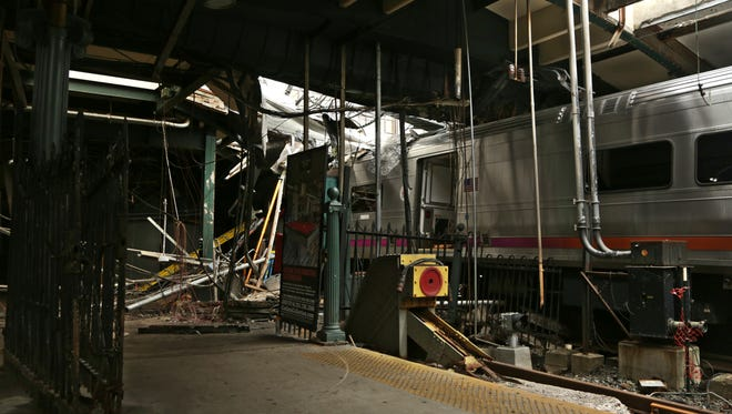 Damage is done to the Hoboken Terminal in Hoboken after a commuter train crash  killed one person and injured more than 100 others.