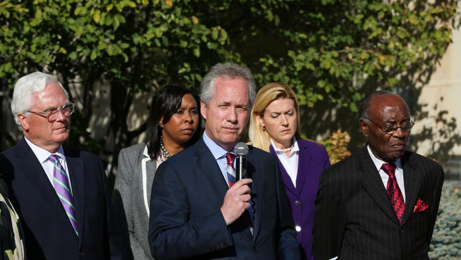 Louisville mayor Greg Fischer announces Wal-Mart is pulling out of the deal to build in west Louisville. From left to right are County Attorney Mike O'Connell, Nicole Yates, Fischer, Mary Ellen Wiederwohl and Reverend Charles Elliott. Oct. 28, 2016