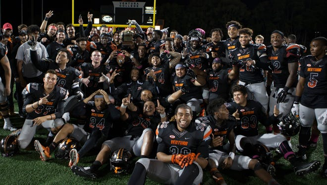 The Ventura College football team celebrates its victory over Moorpark College in the annual Citrus Cup.