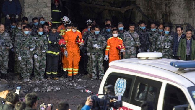In this Tuesday, Nov. 1, 2016 photo released by Xinhua News Agency, rescuers mourn for victims at Jinshangou Coal Mine in Chongqing, southwest China.