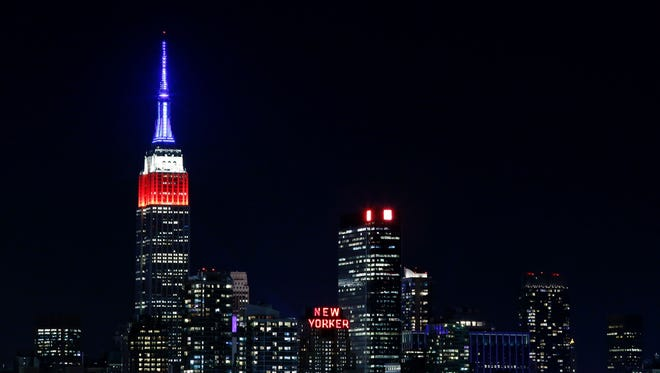The Empire State Building in New york is lit in red, white and blue.