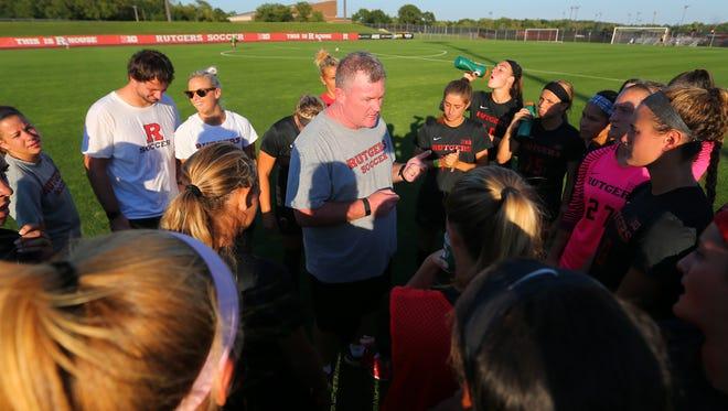 Rutgers women's soccer coach Mike O'Neill addresses his team.