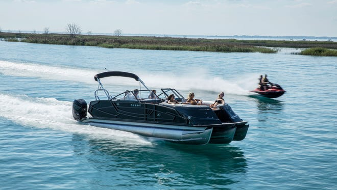 This Crest Pontoon triple-tube pontoon boat is powered by twin 400-horsepower Mercury Marine outboard engines.