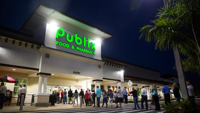 Shoppers line up outside before the grand opening of the Orangetree Publix in Golden Gate Estates on Thursday, March 23, 2017.