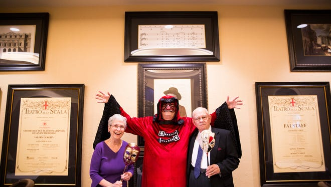 Joann Buffo, from left, Ron Bowman and Gene Buffo stand Friday, March 31, 2017, at The Terraces at Bonita Springs. Bowman holds his arms up while wearing a devil costume that was worn for Halloween performances. The Naples Opera Society will be hosting a farewell concert Monday and, in May, a final trip to see a show in Miami.