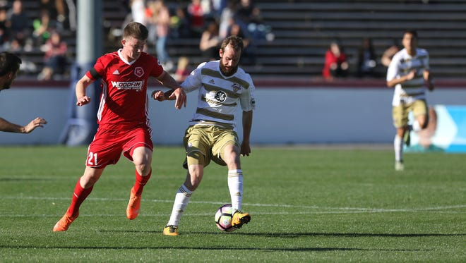Louisville City FC midfielder Brian Ownby controls the ball with Richmond Kickers midfielder Chris Durkin alongside him. Louisville City won the game on April 8, 2017, 1-0 at Richmond
