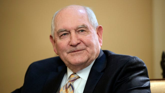 FILE - In this Feb. 1, 2017, file photo, Agriculture Secretary-designate, former Georgia Gov. Sonny Perdue attends a meeting on Capitol Hill in Washington. Perdue says he will step down from several positions at companies bearing his name, restructure family trusts and create blind trusts to avoid a conflict of interest if he is confirmed. (AP Photo/J. Scott Applewhite, File) ORG XMIT: WX111