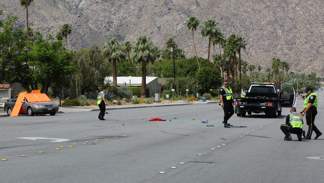 Police investigate the site of a fatal collision on Ramon Road in Palm Springs.  An elderly man in a sedan was killed when a tow truck crashed into the vehicle.
