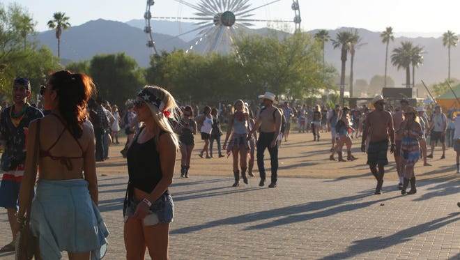 Apr 30, 2017; Indio, CA, USA; Crowds walk through the festival grounds during the Stagecoach Country Music Festival at Empire Polo Club. Mandatory Credit: Zoe Meyers/The Desert Sun via USA TODAY NETWORK