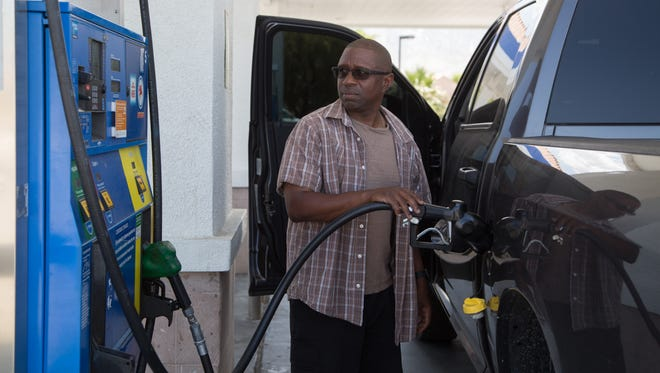 Kenny Davis puts gas into his truck in Palm Springs, California on May 4, 2017.